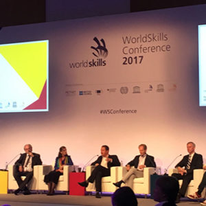 Georgette Yakman participating in a panel discussion during the World Skills Conference.